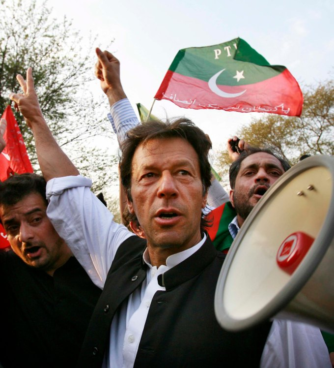 Khan, the chief of Tehrik-e-Insaf party, chants slogans against Pakistani President Musharraf during protest in Islamabad